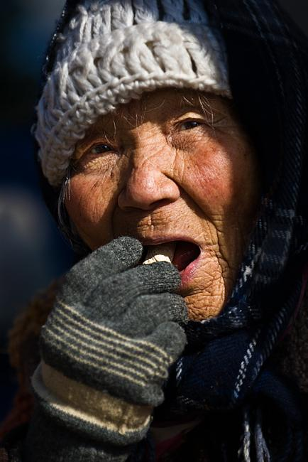 Old woman eating home made candy, Korea