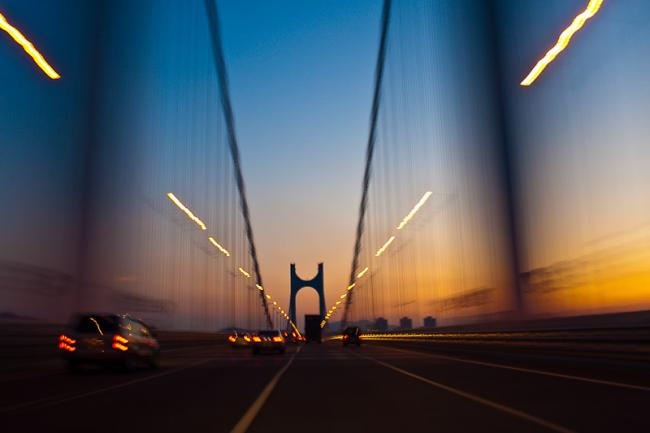 Driving Gwangan bridge in sunset, Busan, Korea – wide