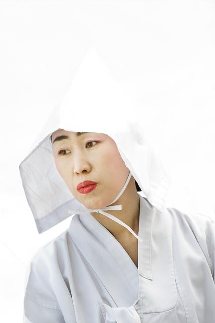 Korean woman in traditional white dress and hood