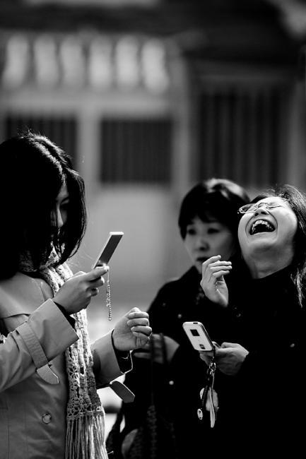 Young women having fun with mobile phones