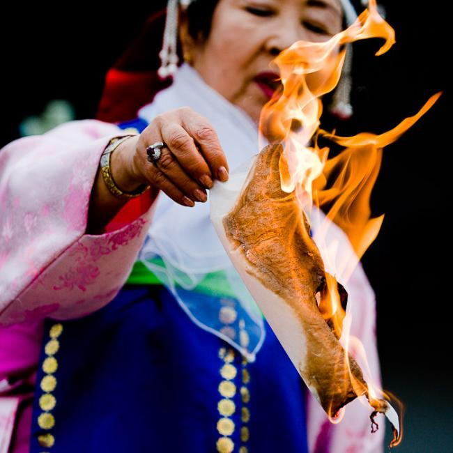 Korean shaman, burning something