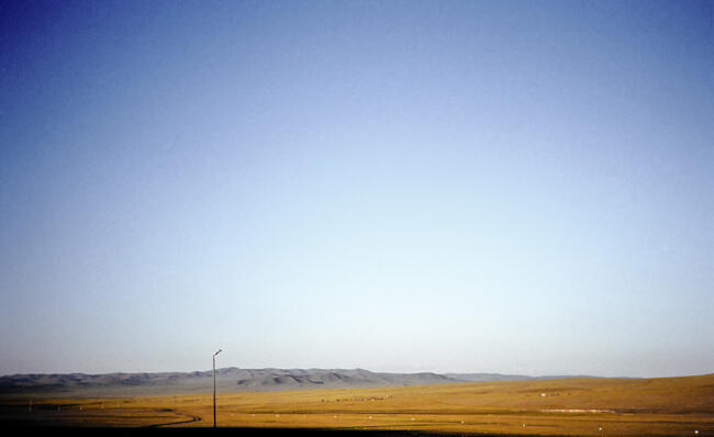 Mongolian steppe and lightpost
