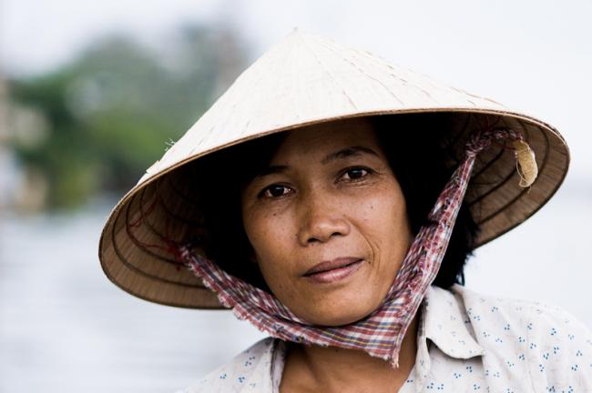 Porptrait of a Vietnamese woman on her boat