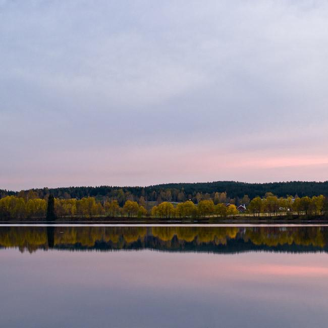 Quiet lake, autumn evening.