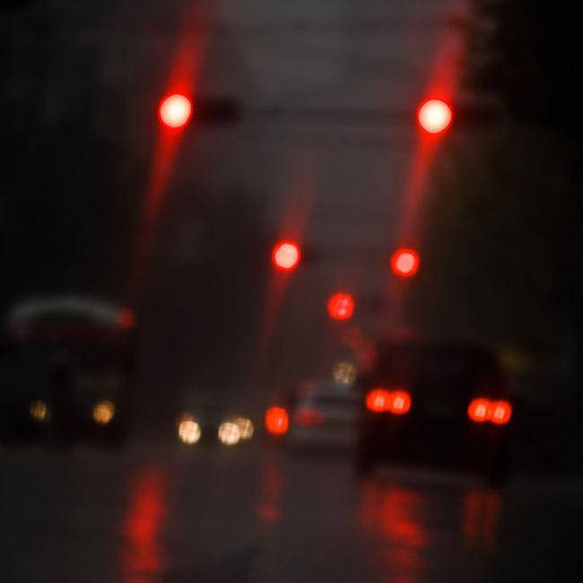 Red lights on wet street
