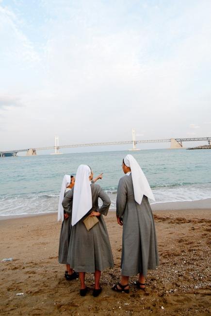 Three catholic nuns at the beach