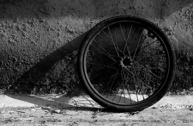 A wheel resting against the wall