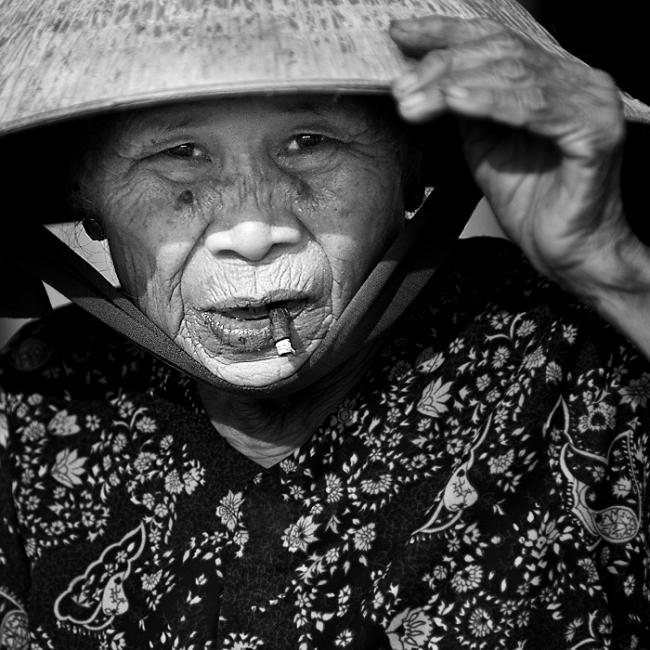 Portrait of a woman smoking a cigar, Vietnam