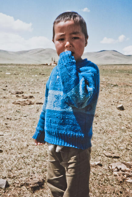 Mongolian boy in blue sweater