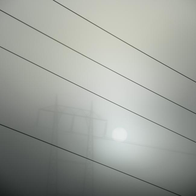 Power lines, fog and sun