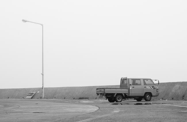 Parked pickup truck and lightpost