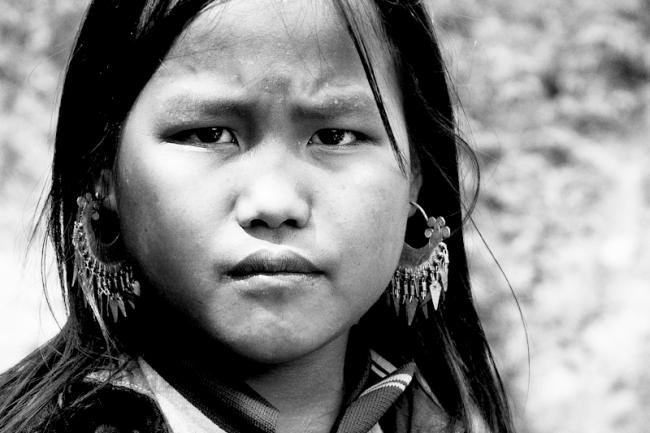 Black Hmong girl with a sharp eye. Sapa, Vietnam