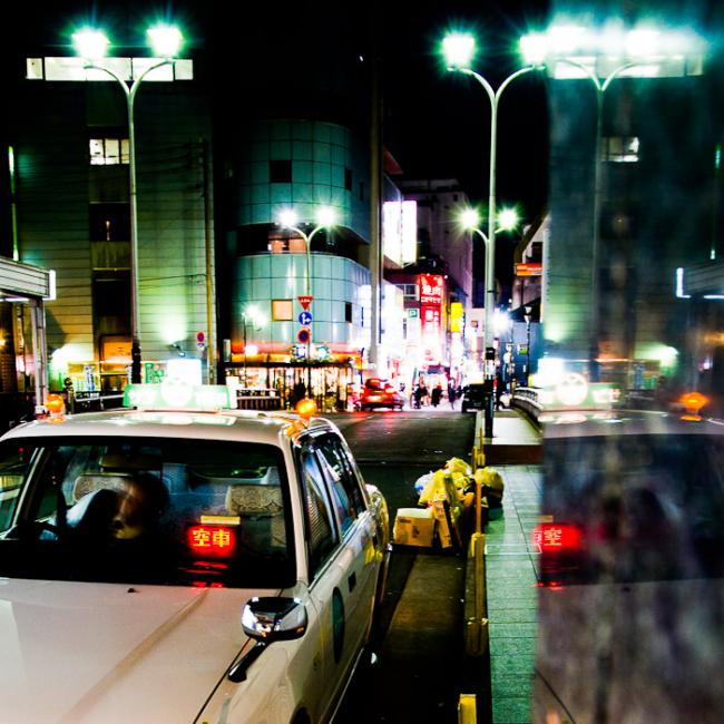 Taxi driver waiting for passengers in the Fukuoka night