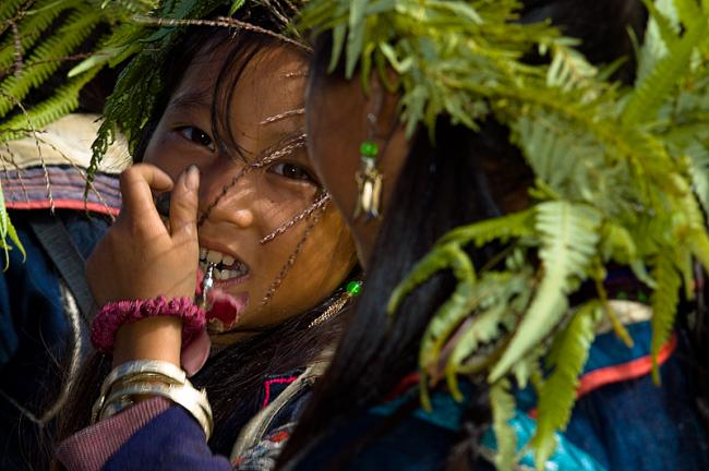 Black Hmong girl with fern in her hair, Sapa, Vietnam
