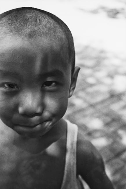 Black and white portrait of a Chinese boy